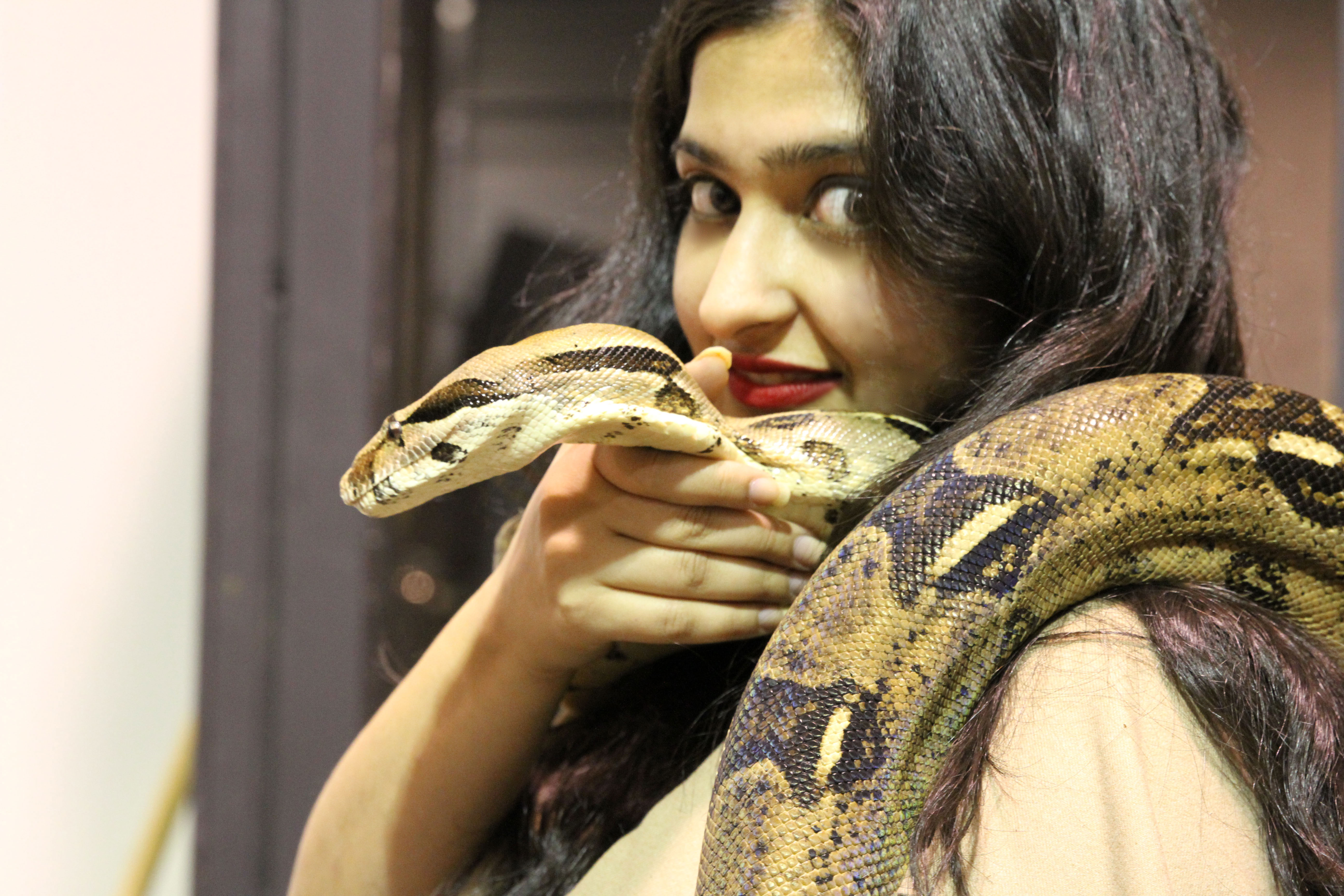 The Screen Girls Sarah holding ball python