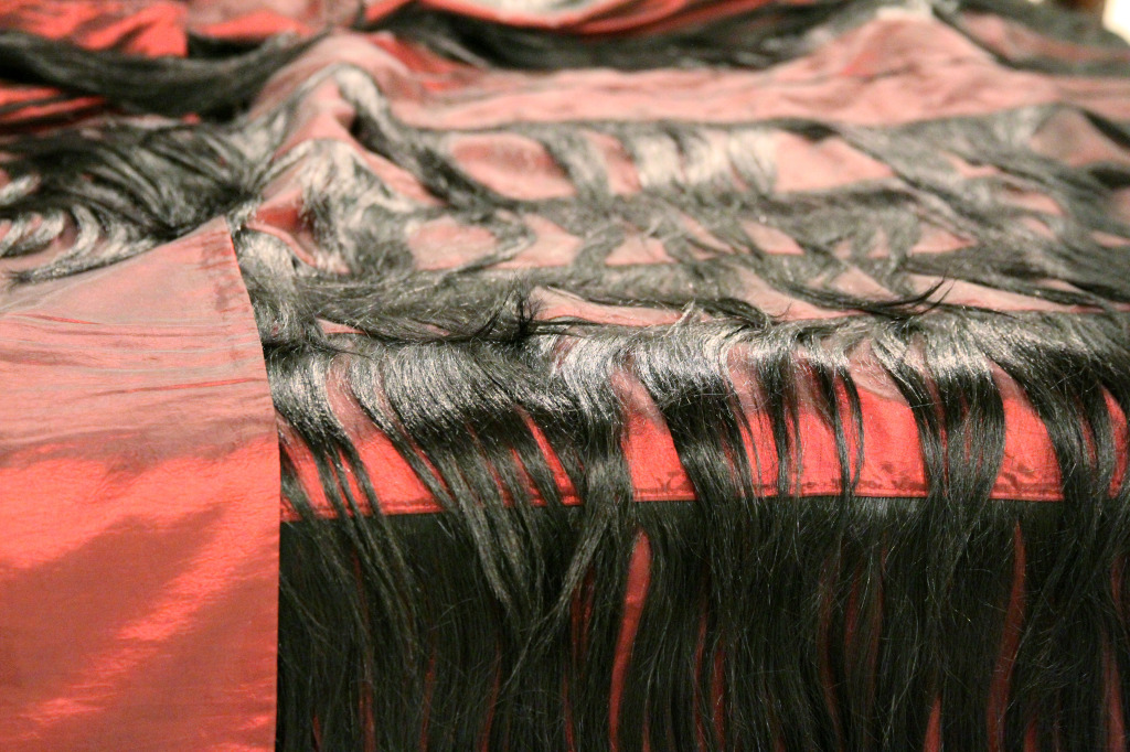 Bed covered in hair at FUSE: The Noise of Silence at the Vancouver Art Gallery